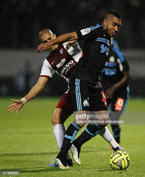 Metz' French Algerian midfielder Ahmed Kashi vie for the ball with Marseille's French forward Dimitri Payet during the French L1 football match...