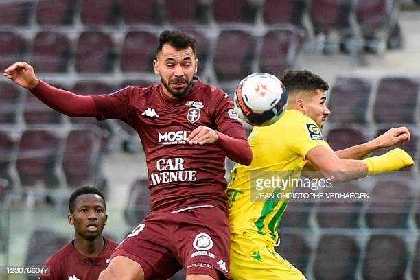 Metz' French Algerian midfielder Farid Boulaya and Nantes' Algerian midfielder Mehdi Abeid fight for the ball during the French L1 football match...