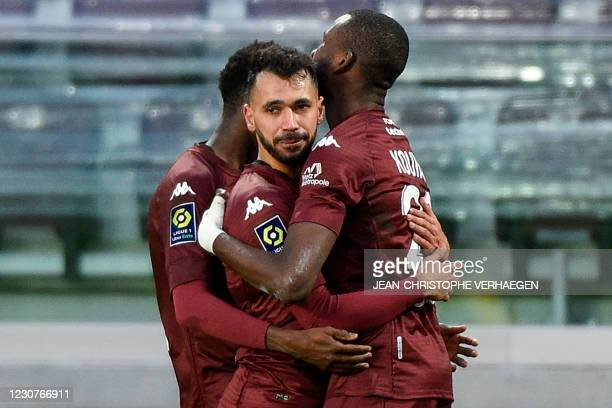 Metz' French Algerian midfielder Farid Boulaya celebrates with teammates after scoring a goal during the French L1 football match between FC Metz and...
