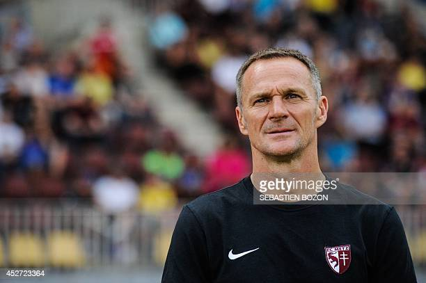 Metz' French coach Albert Cartier looks on during the friendly football match Sochaux vs Metz on July 25 at the stade de l'Ill in Mulhouse, eastern...