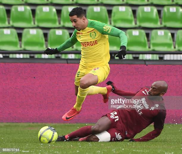 Metz' French defender Jonathan Rivierez vies with Nantes' Belgium midfielder Yassine El Ghanassy during the French L1 football match Metz vs Nantes...