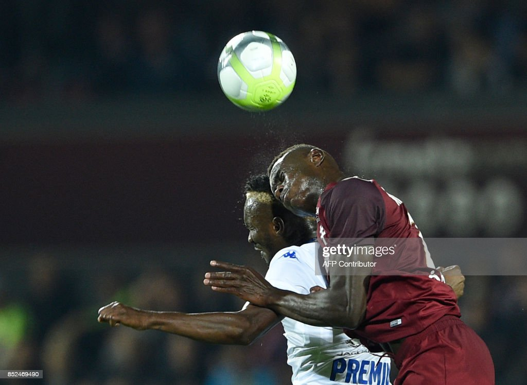 Metz' French defender Moussa Niakhate (R) vies for the ball with Troyes' Malian forward Adama Niane during the French L1 football match between Metz (FCM) and Troyes (ESTAC) on September 23, 2017 at Saint Symphorien stadium in Longeville-Les-Metz, eastern France. VERHAEGEN