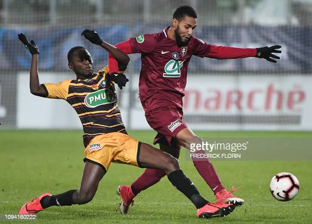 Metz' French forward Marvin Gakpa vies with Orleans' Senegalese midfielder Joseph Lopy during the French Cup round of 16 football match Football Club...