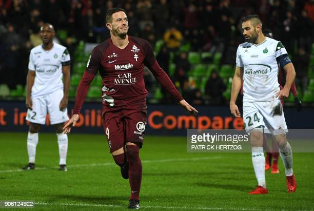 Metz' French forward Nolan Roux celebrates after scoring a goal during the French L1 football match between Metz and SaintEtienne at the...