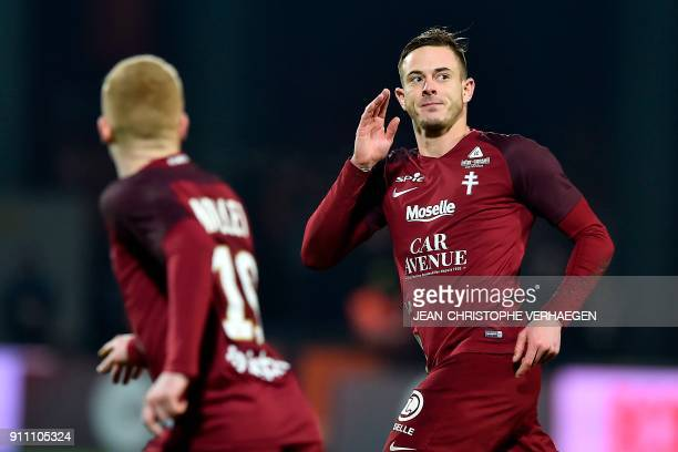 Metz' French forward Nolan Roux celebrates after scoring during the French L1 football match between Metz and Nice on January 27 2018 at the...
