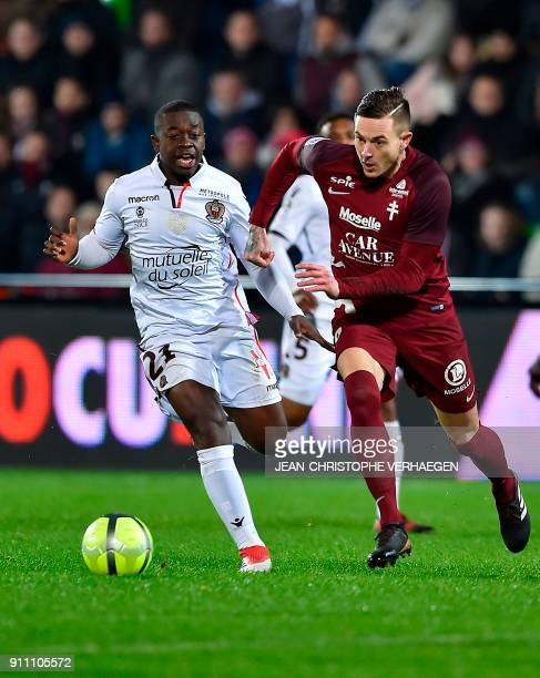 Metz' French forward Nolan Roux outruns Nice's French midfielder Nampalys Mendy during the French L1 football match between Metz and Nice on January...