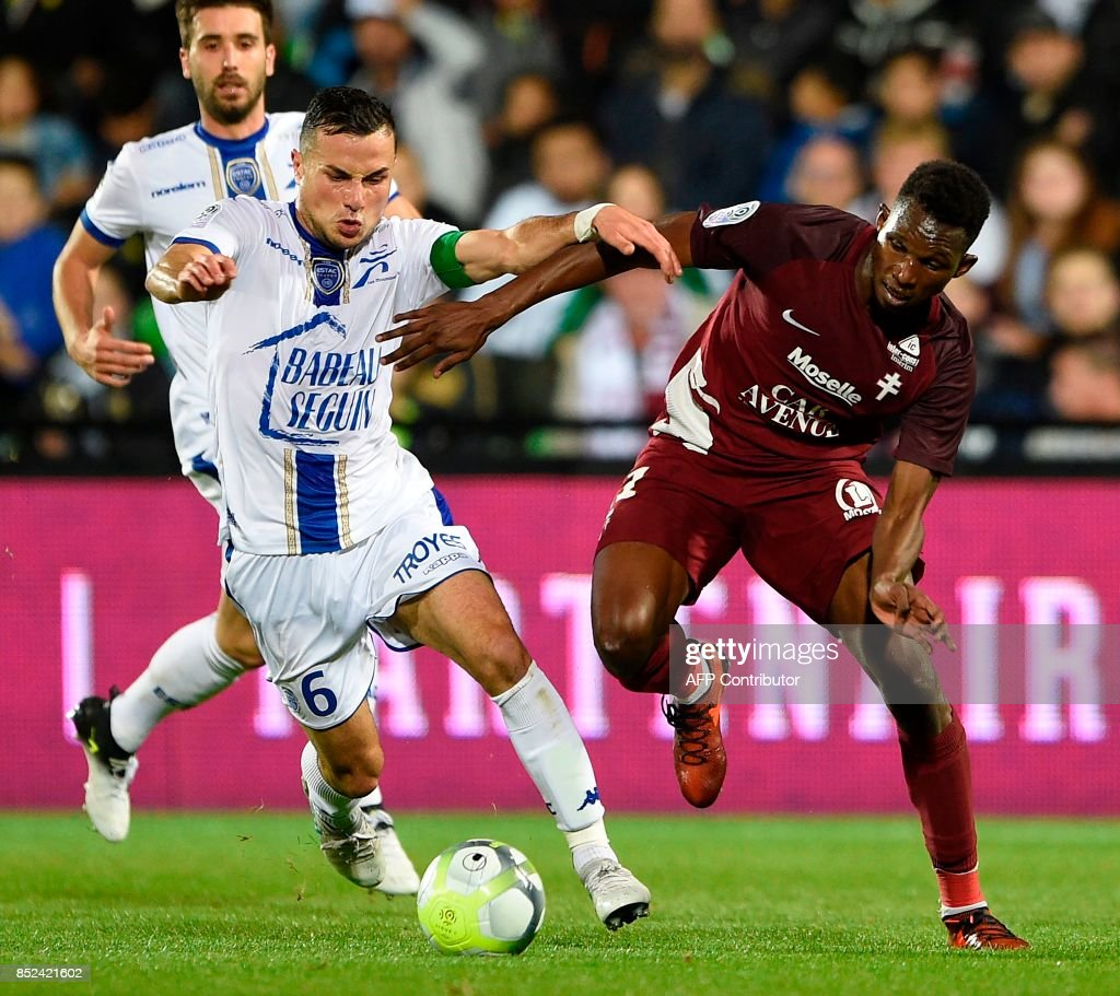 Metz' French forward Opa Nguette (R) vies for the ball with Troyes' French midfielder Karim Azamoum during the French L1 football match between Metz (FCM) and Troyes (ESTAC) on September 23, 2017 at Saint Symphorien stadium in Longeville-Les-Metz, eastern France. VERHAEGEN