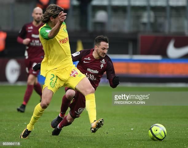 Metz' French midfielder Danijel Milicevic vies with Nantes' Slovenian midfielder Rene Krhin during the French L1 football match Metz vs Nantes on...