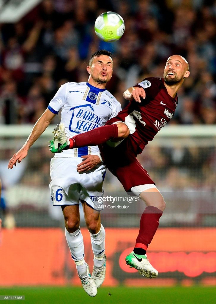 Metz' French midfielder Renaud Cohade (R) vies for the ball with Troyes' French midfielder Karim Azamoum during the French L1 football match between Metz (FCM) and Troyes (ESTAC) on September 23, 2017 at Saint Symphorien stadium in Longeville-Les-Metz, eastern France. VERHAEGEN