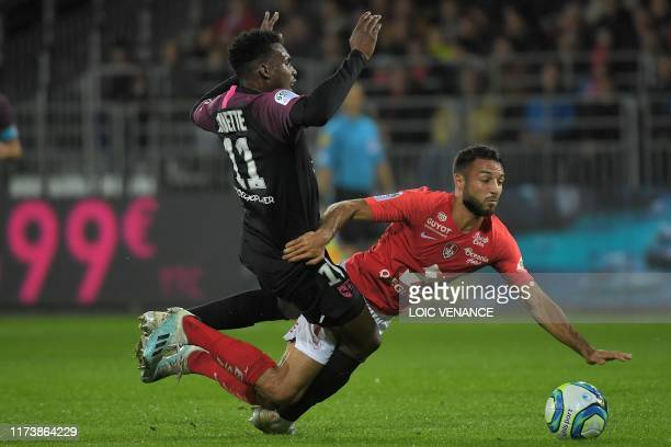 Metz' French-Senegalese midfielder Opa Nguette vies with Brest's French midfielder Haris Belkebla during the French L1 football match between Stade...