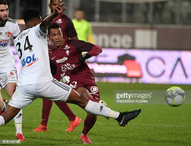 Metz' FrenchTogolese forward Mathieu Dossevi vies with Amiens' French midfielder Bongani Zungu during the French L1 football match Metz vs Amiens on...