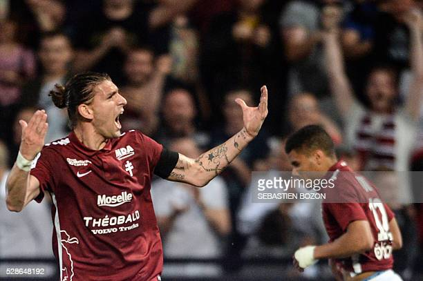 Metz' Italian defender Guido Milan celebrates after scoring a goal during the French L2 football match between Metz and Tours on May 6, 2016 at the...