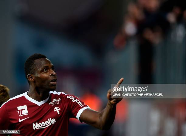 Metz' Malian forward Cheick Diabate celebrates after scoring during the French L1 football match between Metz and Paris on April 18 2017 at Saint...