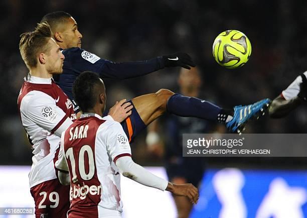 Metz' midfielder Sergei Krivets from Belarus and French midfielder Bouna Sarr vie with Montpellier's French midfielder Joris Marveaux during the...