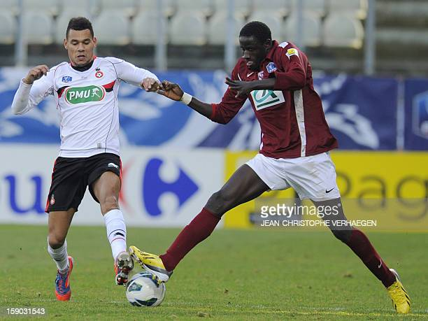 Metz' Moussa Gueye vies with Nice's Thimotee Kolodziejczak during the French Cup football match Metz vs Nice at SaintSymphorien Stadium on January 6...