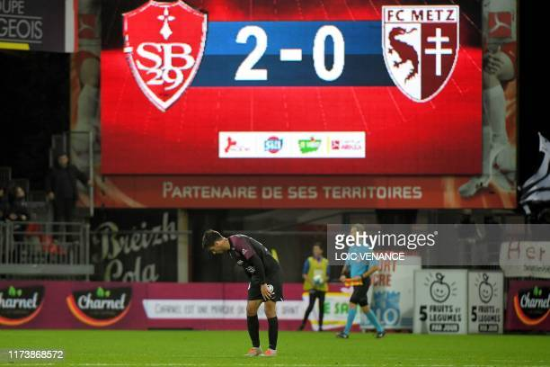 Metz' player reacts at the end of the French L1 football match between Stade Brestois 29 and Football Club de Metz at the Francis Le Ble stadium in...