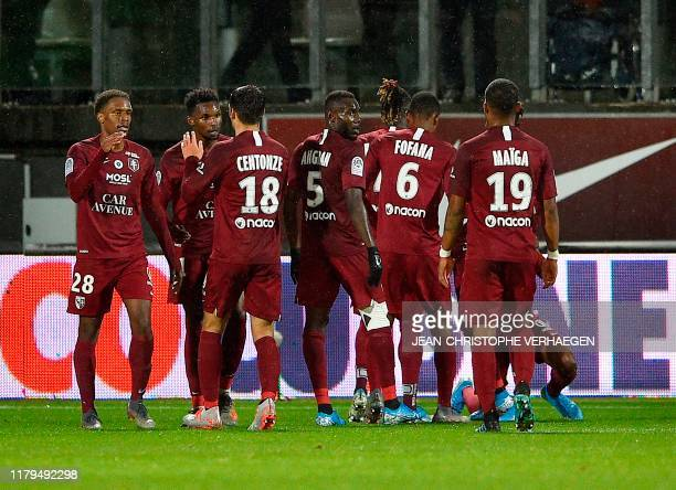 Metz' players celebrate after scoring during the French L1 football match between FC Metz and Montpellier Herault SC at the SaintSymphorien stadium...