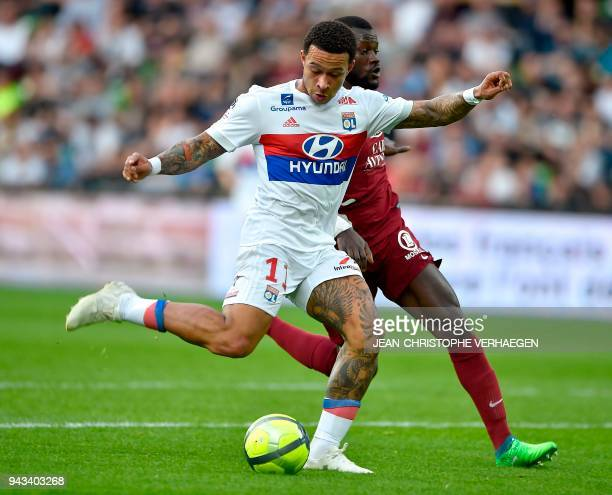 Metz' Senegalese defender Fallou Diagne vies for the ball with Lyon's Dutch forward Memphis Depay during the French L1 football match between Metz...