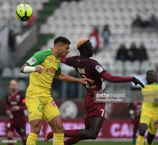 Metz' Senegalese defender Fallou Diagne vies with Nantes' Brazilian defender Diego Carlos during the French L1 football match Metz vs Nantes on March...