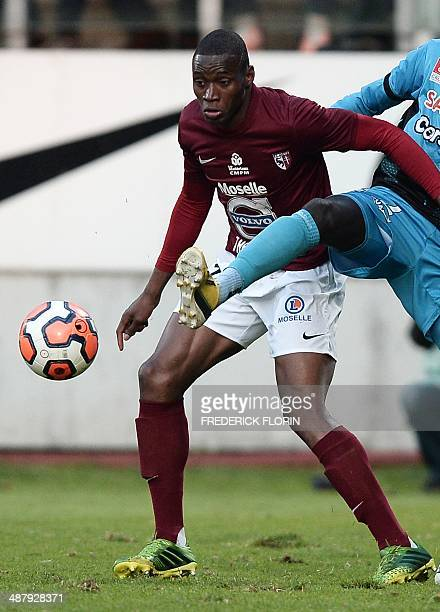 Metz' Senegalese forward Diafra Sakho fights for the ball during the French L2 football match FC Metz vs Tours FC on May 2 2014 at the...