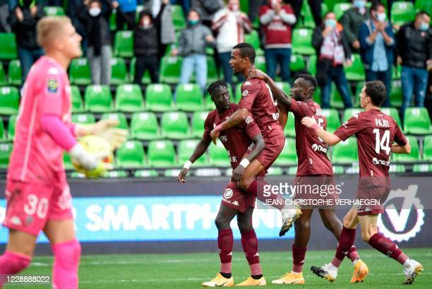 Metz' Senegalese forward Ibrahima Niane celebrates with team mates after scoring a goal during the French L1 football match between Metz and Lorient...