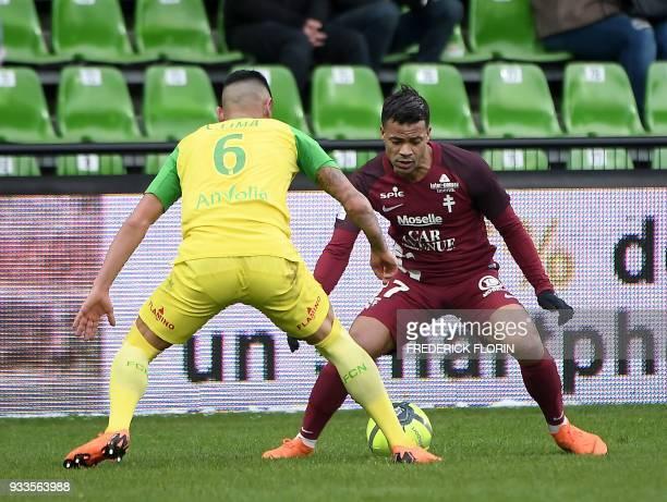 Metz' Senegalese forward Ibrahima Niane vies with Nantes' Brazilian defender Lucas Lima during the French L1 football match Metz vs Nantes on March...