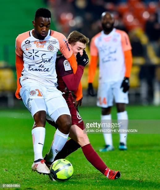 Metz' Spanish defender Ivan Balliu vies for the ball with Montpellier's French forward Isaac Mbenza during the French Ligue 1 football match between...