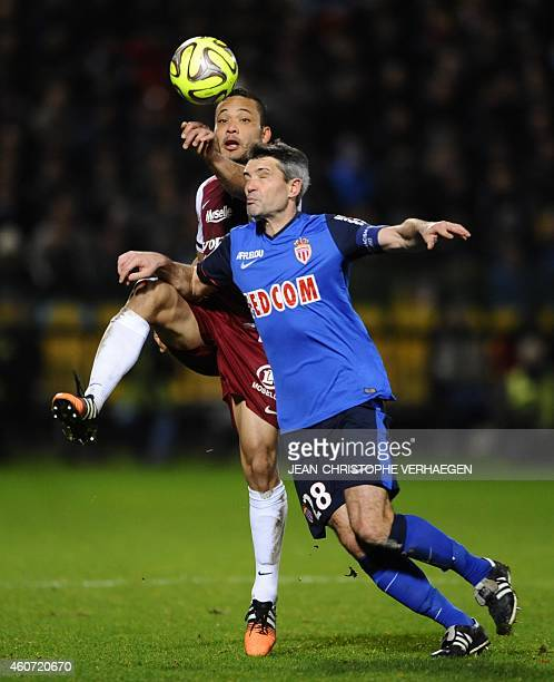 Metz' Venezuelan forward Juan Manuel Falcon vies for the ball with Monaco's French midfielder Jeremy Toulalan during the French L1 football match...