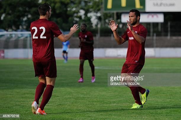 Metz' Venezuelian forward Juan Manuel Falcon is congratulated by Metz' French midfielder Kevin Lejeune after scoring a goal during the friendly...
