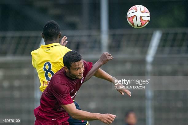 Metz' Venezuelian forward Juan Manuel Falcon vies with Sochaux' Senegalese midfielder Joseph Lopy during the friendly football match Sochaux vs Metz...