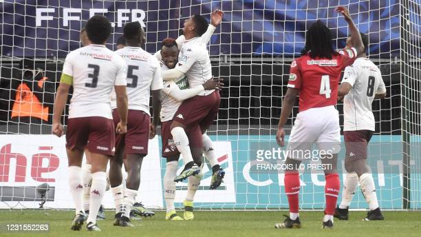 Metz's French forward Thierry Ambrose celebrates with teammates after scoring during the French Cup round-of-32 football match between Valenciennes...