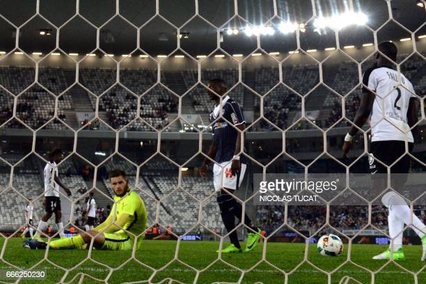 Metz's French goalkeeper Thomas Didillon reacts after taking goal during the French Ligue 1 football match between Bordeaux and Metz on April 8 2017...