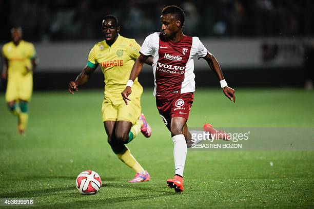 Metz's French midfielder Bouna Sarr vies with Nantes' French defender Issa Cissokho during the French L1 football match between FC Metz and FC Nantes...