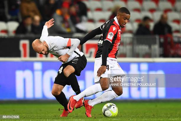 Metz's French midfielder Renaud Cohade vies with Nice's Brazilian defender Santos Marlon during the French L1 football match Nice vs Metz on December...