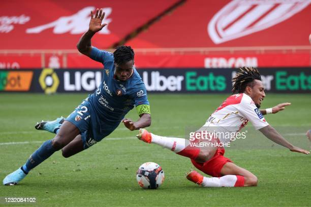 Metz's Ghanaian defender John Boye tackles Monaco's Portuguese midfielder Gelson Martins during the French L1 football match between AS Monaco and FC...