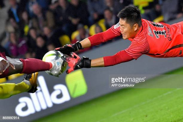 Metz's Japanese goalkeeper Eiji Kawashima makes a save during the French L1 football match Nantes vs Metz at La Beaujoire stadium in Nantes western...