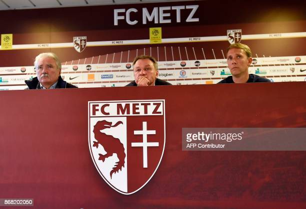 Metz's newly appointed French headcoach Frederic Hantz flanked by Metz's president Bernard Serin and Metz's assistant coach Arnaud Cormier gives a...