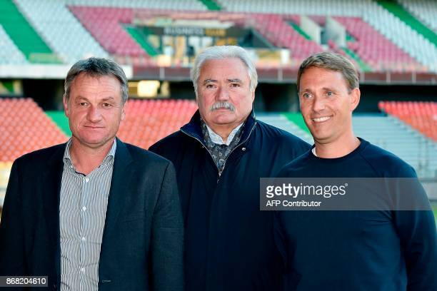 Metz's newly appointed French headcoach Frederic Hantz Metz's president Bernard Serin and Metz's assistant coach Arnaud Cormier pose for photographs...