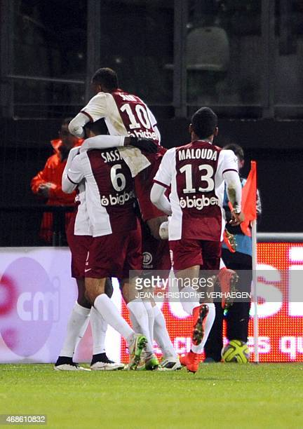 Metz's players celebrate after scoring during the French L1 football match between Metz and Toulouse on April 4 2015 at the Saint Symphorien stadium...