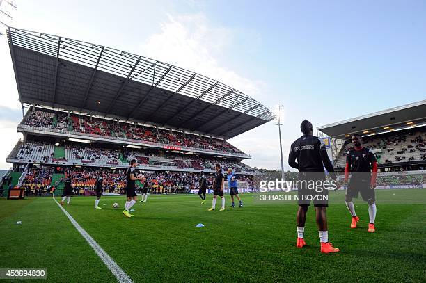 Metz's players warm up before the French L1 football match between FC Metz and FC Nantes on August 16 2014 at the SaintSymphorien stadium in...