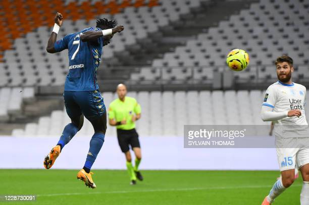 Metz's Senegalese forward Ibrahima Niane heads the ball and scores a goal during the French L1 football match between Olympique de Marseille and FC...