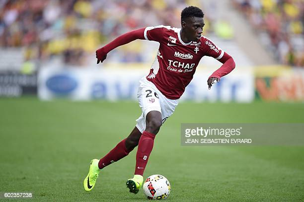 Metz's Senegalese midfielder Ismaila Sarr runs with the ball during the French L1 football match between Nantes and Metz on September 11 2016 at the...