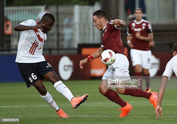 Metz's Turkish forward Mevlut Erding vies with Lille's French midfielder Ibrahim Amadou during the French Ligue 1 football match between FC Metz and...