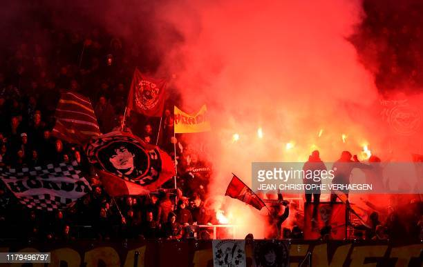 Metz'supporters light flares during the French L1 football match between FC Metz and Montpellier Herault SC at the Saint-Symphorien stadium in...