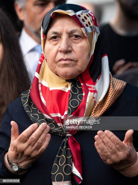 Mevluede Genc who lost two daughters two granddaughters and a niece in the neoNazi arson attack in Solingen in 1993 prays during a memorial marking...