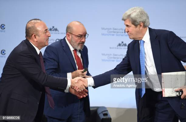 Mevlut Cavusoglu Minister of Foreign Affairs of Turkey shakes hands with former US Secretary of State John Kerry as they are flanked by Yacoub Riad...
