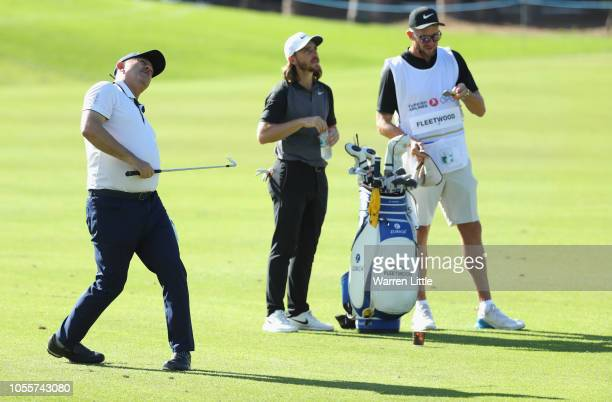 Mevlut Cavusoglu Minister of Foriegn Affairs plays a shot in the pro am watched by Tommy Fleetwood of England ahead of the Turkish Airlines Open at...