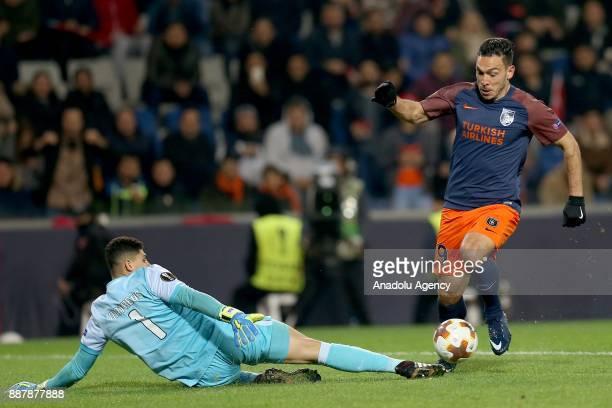 Mevlut Erdinc of Medipol Basaksehir in action against Matheus of Braga during UEFA Europa League Group C soccer match between Medipol Basaksehir and...
