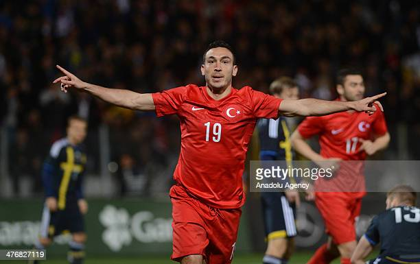 Mevlut Erdinc of Turkey celebrates after scoring a goal during an international friendly soccer match between Turkey and Sweden at the 19 Mayis...