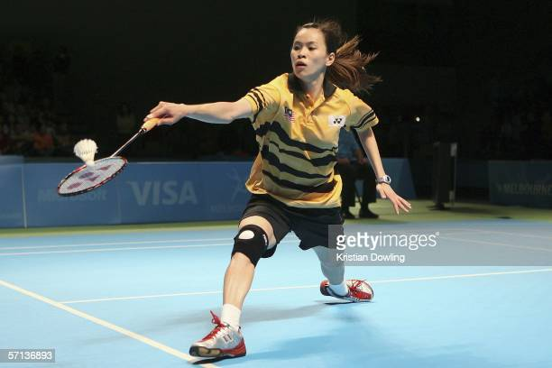 Mew Wong of Malaysia plays a backhand during the gold medal mixed team badminton match against Jayne Tracey Hallam of England on day five of the...